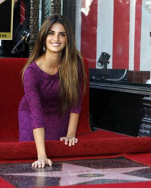 Actress Penelope Cruz touches her star on the Walk of Fame after it was unveiled in Hollywood