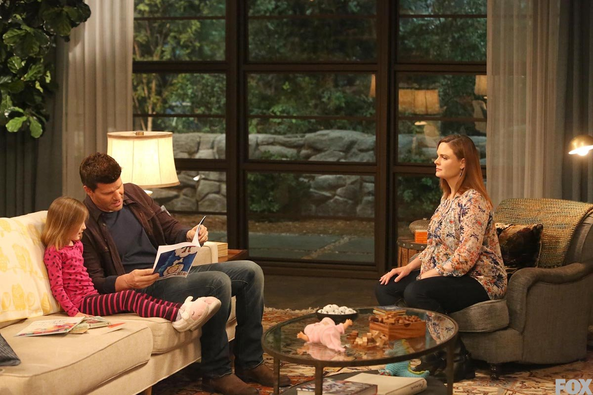 Booth stops by the house to read bedtime stories to Christine