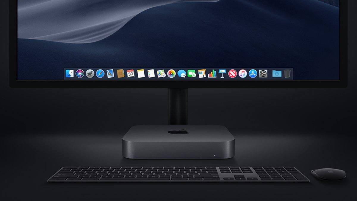 Mac Mini com Magic Keyboard e Magic Mouse em Space Gray e um monitor